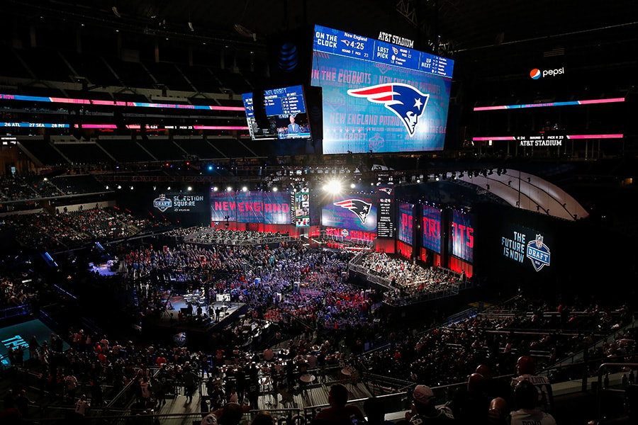 ARLINGTON, TX - APRIL 26: The New England Patriots logo is seen on a video board during the first round of the 2018 NFL Draft at AT&T Stadium on April 26, 2018 in Arlington, Texas. (Photo by Tim Warner/Getty Images)