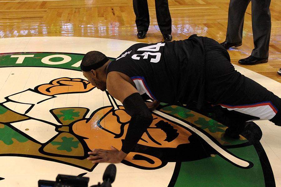 Feb 5, 2017; Boston, MA, USA; LA Clippers forward Paul Pierce (34) kisses the parquet floor one last time during a game against the Boston Celtics at TD Garden. Mandatory Credit: Bob DeChiara-USA TODAY Sports