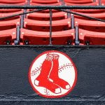 BOSTON, MA - OCTOBER 09: Raindrops are seen on the Boston Red Sox logo after game three of the MLB American League Divison Series between the Boston Red Sox and the Cleveland Indians was postponed due to weather at Fenway Park on October 9, 2016 in Boston, Massachusetts. (Photo by Elsa/Getty Images)