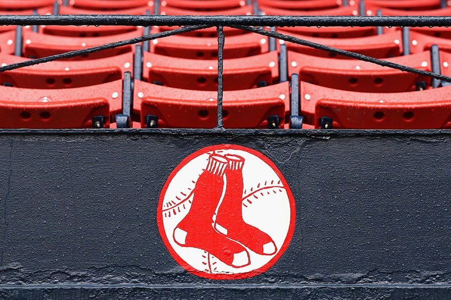 BOSTON, MA - OCTOBER 09: Raindrops are seen on the Boston Red Sox logo after game three of the American League Divison Series between the Boston Red Sox and the Cleveland Indians was postponed due to weather at Fenway Park on October 9, 2016 in Boston, Massachusetts. (Photo by Elsa/Getty Images)