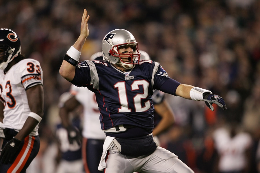 FOXBOROUGH, MA - NOVEMBER 26: Quarterback Tom Brady #12 of the New England Patriots signals first down against the Chicago Bears on November 26, 2006 at Gillette Stadium in Foxborough, Massachusetts. The Patriots defeated the Bears 17-13. (Photo by Elsa/Getty Images)