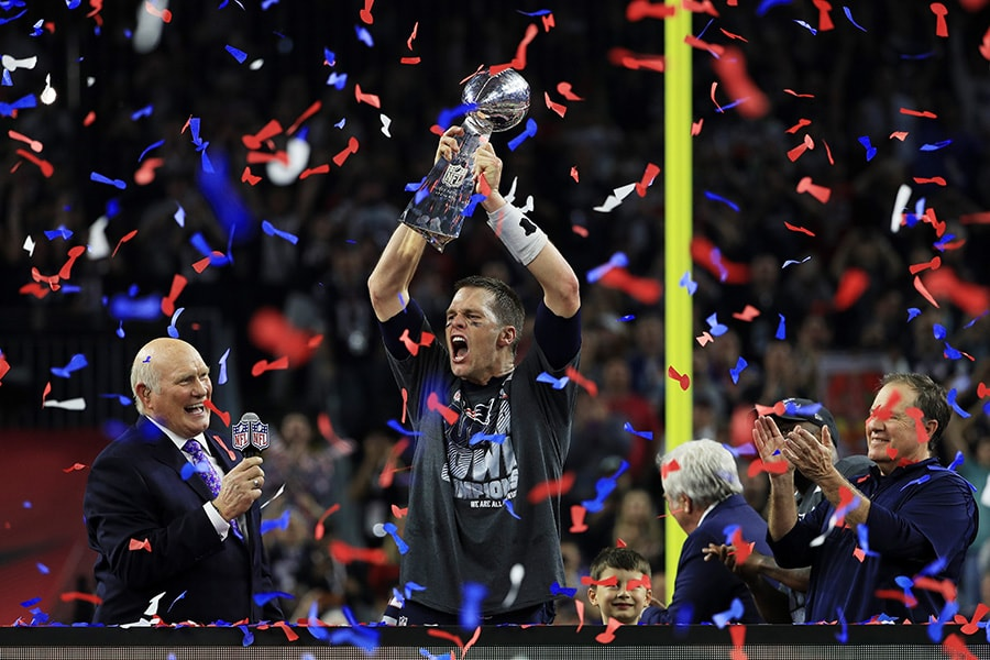 HOUSTON, TX - FEBRUARY 05:  Tom Brady #12 of the New England Patriots holds the Vince Lombardi Trophy after defeating the Atlanta Falcons 34-28 during Super Bowl 51 at NRG Stadium on February 5, 2017 in Houston, Texas.  (Photo by Mike Ehrmann/Getty Images)