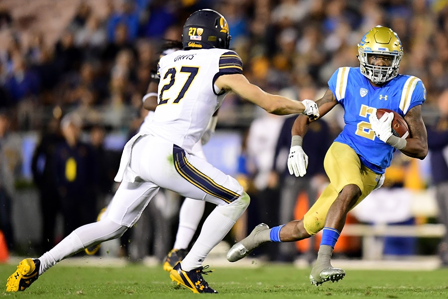 PASADENA, CA - NOVEMBER 24: Jordan Lasley #2 of the UCLA Bruins runs after his catch against Ashtyn Davis #27 of the California Golden Bears during the second quarter at Rose Bowl on November 24, 2017 in Pasadena, California. (Photo by Harry How/Getty Images)