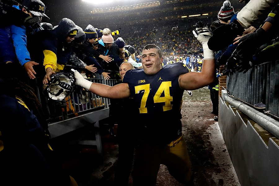 ANN ARBOR, MI - NOVEMBER 19: Ben Bredeson #74 of the Michigan Wolverines leaves the field after a 20-10 win over the Indiana Hoosiers on November 19, 2016 at Michigan Stadium in Ann Arbor, Michigan. (Photo by Gregory Shamus/Getty Images)
