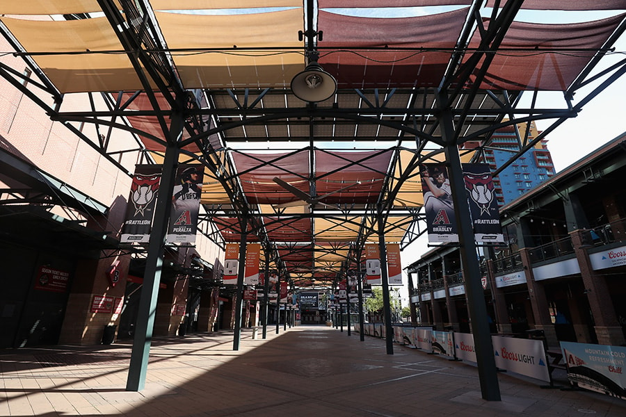 PHOENIX, ARIZONA - MARCH 26: The walkways outside of Chase Field are empty of fans on March 26, 2020 in Phoenix, Arizona. The Arizona Diamondbacks and the Atlanta Braves were scheduled to play a Major League Baseball opening day game tonight, which was postponed due to the coronavirus (COVID-19) global pandemic. (Photo by Christian Petersen/Getty Images)