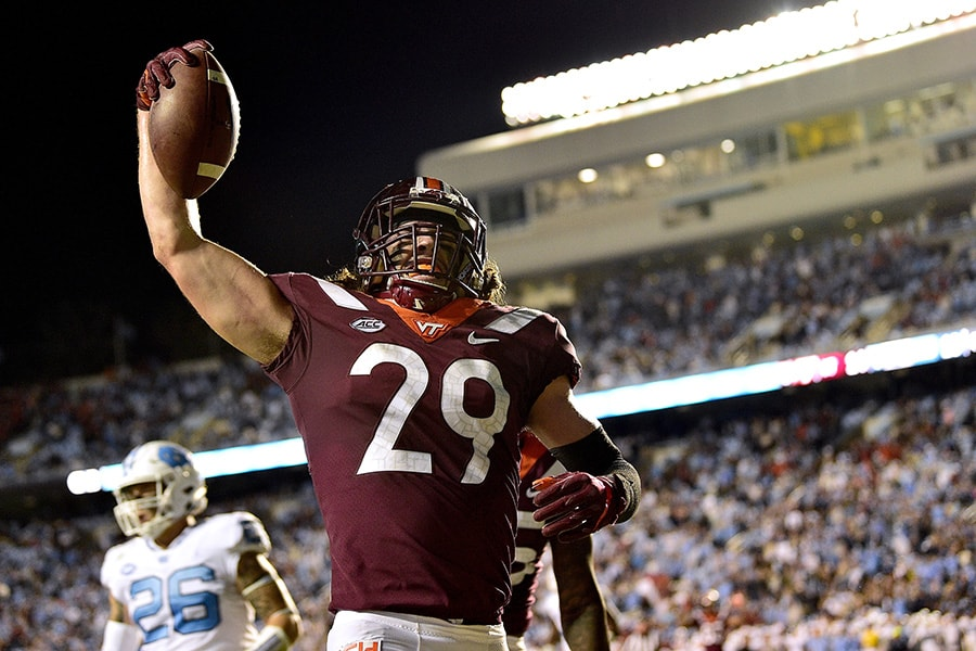 CHAPEL HILL, NC - OCTOBER 13: Dalton Keene #29 of the Virginia Tech Hokies reacts after scoring the game-winning touchdown against the North Carolina Tar Heels during their game at Kenan Stadium on October 13, 2018 in Chapel Hill, North Carolina. Virginia Tech won 22-19. (Photo by Grant Halverson/Getty Images)