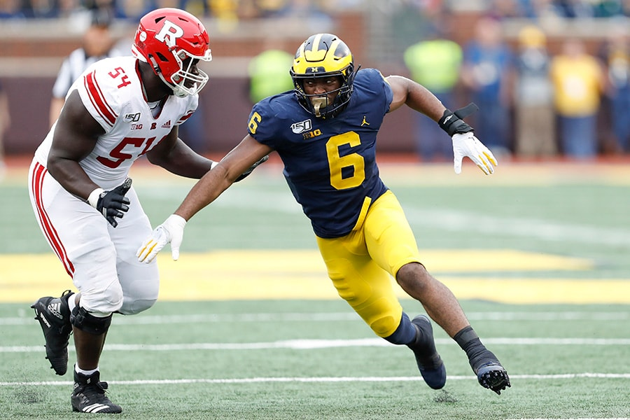 Sep 28, 2019; Ann Arbor, MI, USA; Michigan Wolverines linebacker Josh Uche (6) fights for position against Rutgers Scarlet Knights offensive lineman Kamaal Seymour (54) during the third quarter at Michigan Stadium. Mandatory Credit: Raj Mehta-USA TODAY Sports