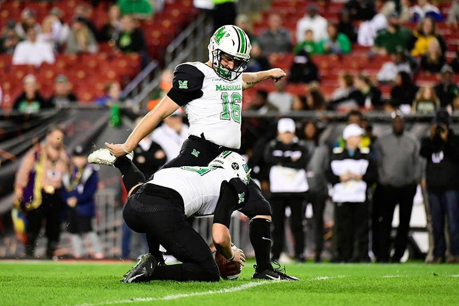 TAMPA, FLORIDA - DECEMBER 20: Justin Rohrwasser #16 of the Marshall Thundering Herd kicks an extra point during the first quarter against the South Florida Bulls in the Gasparilla Bowl at Raymond James Stadium on December 20, 2018 in Tampa, Florida. (Photo by Julio Aguilar/Getty Images)