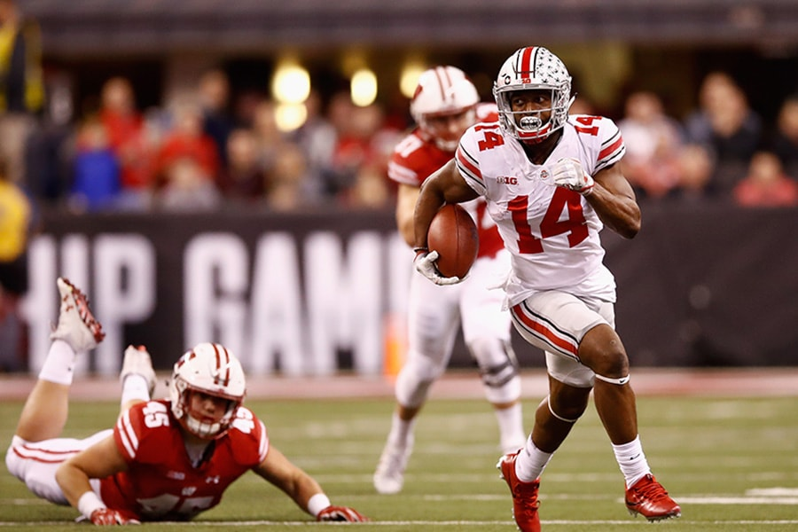 INDIANAPOLIS, IN - DECEMBER 02:  Wide receiver K.J. Hill #14 of the Ohio State Buckeyes runs the ball against fullback Alec Ingold #45 of the Wisconsin Badgers in the second half during the Big Ten Championship game at Lucas Oil Stadium on December 2, 2017 in Indianapolis, Indiana.  (Photo by Andy Lyons/Getty Images)