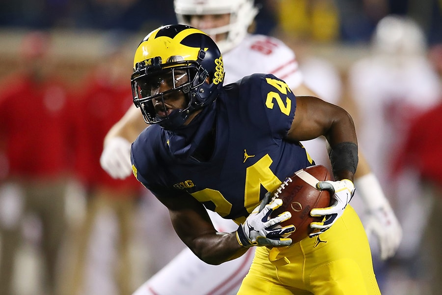 ANN ARBOR, MI - OCTOBER 13: Lavert Hill #24 of the Michigan Wolverines intercepts a second half pass and returns is for a touchdown while playing the Wisconsin Badgers on October 13, 2018 at Michigan Stadium in Ann Arbor, Michigan. (Photo by Gregory Shamus/Getty Images)