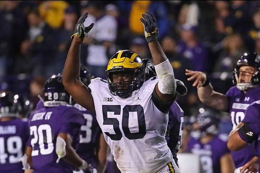 EVANSTON, IL - SEPTEMBER 29: Michael Onwenu #50 of the Michigan Wolverines celebrates a defensive stop against the Northwestern Wildcats at Ryan Field on September 29, 2018 in Evanston, Illinois. Michigan defeated Northwestern 20-17. (Photo by Jonathan Daniel/Getty Images)