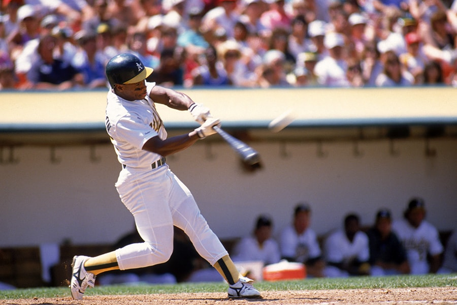 OAKLAND, CA - 1989: Rickey Henderson #22 of the Oakland Athletics connects with a pitch during the 1989 season game at the Oakland-Alameda County Coliseum in Oakland, California. (Photo by Otto Greule Jr/Getty Images)