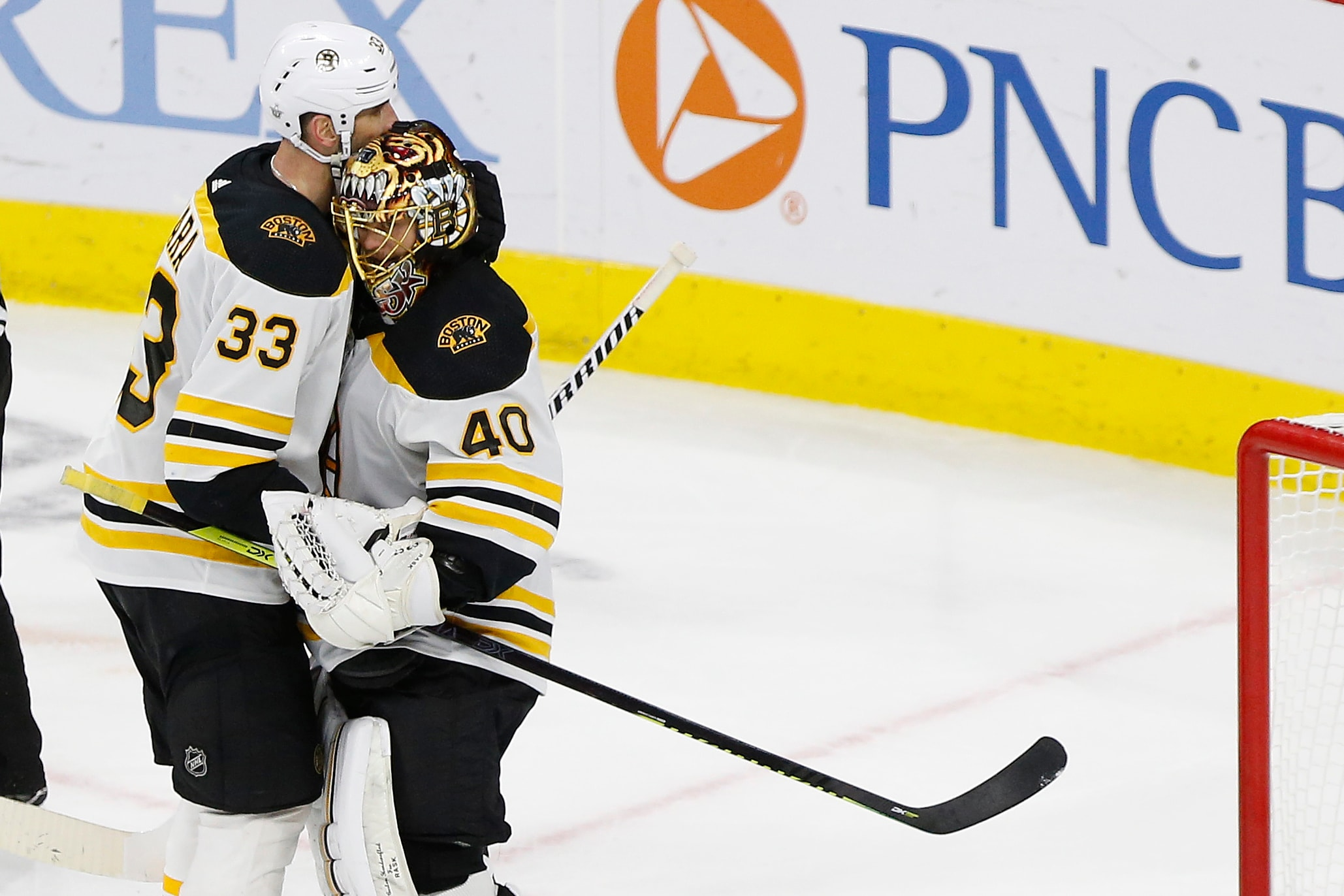 May 14, 2019; Raleigh, NC, USA; Boston Bruins goaltender Tuukka Rask (40) celebrates with Bruins defenseman Zdeno Chara (33) after their game against the Carolina Hurricanes in game three of the Eastern Conference Final of the 2019 Stanley Cup Playoffs at PNC Arena. The Bruins won 2-1 and lead the series 3-0. Mandatory Credit: Geoff Burke-USA TODAY Sports