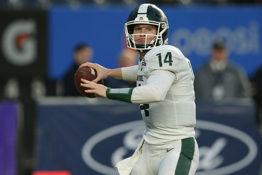 Dec 27, 2019; Bronx, New York, USA; Michigan State quarterback Brian Lewerke (14) throws a pass against the Wake Forest Demon Deacons during the first quarter of the Pinstripe Bowl at Yankee Stadium. Mandatory Credit: Brad Penner-USA TODAY Sports