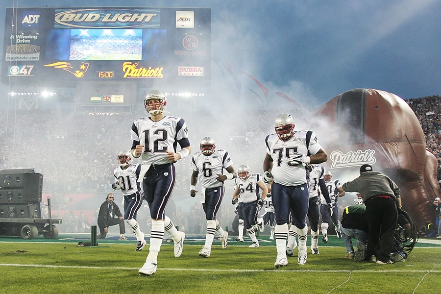 JACKSONVILLE, FLORIDA - FEBRUARY 06: Quarterback Tom Brady #12 of the New England Patriots leads his team onto the field before the start of Super Bowl XXXIX against the Philadelphia Eagles at Alltel Stadium on February 6, 2005 in Jacksonville, Florida. (Photo by Jed Jacobsohn/Getty Images)