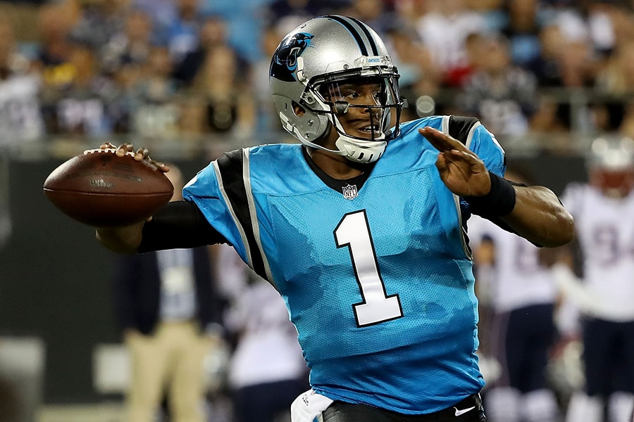 CHARLOTTE, NC - AUGUST 24: Cam Newton #1 of the Carolina Panthers throws a pass against the New England Patriots in the second quarter during their game at Bank of America Stadium on August 24, 2018 in Charlotte, North Carolina. (Photo by Streeter Lecka/Getty Images)