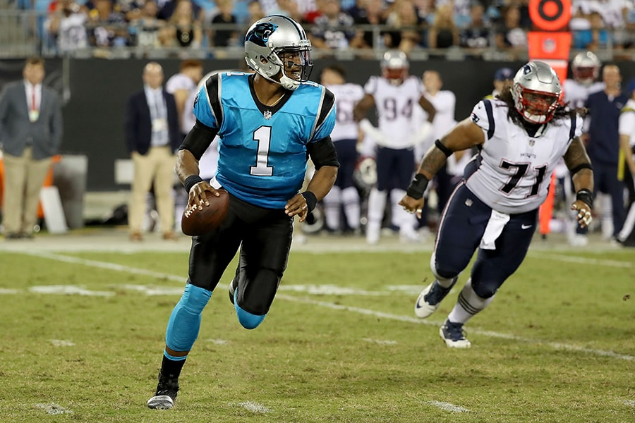 CHARLOTTE, NC - AUGUST 24: Cam Newton #1 of the Carolina Panthers runs the ball against the New England Patriots in the second quarter during their game at Bank of America Stadium on August 24, 2018 in Charlotte, North Carolina. (Photo by Streeter Lecka/Getty Images)