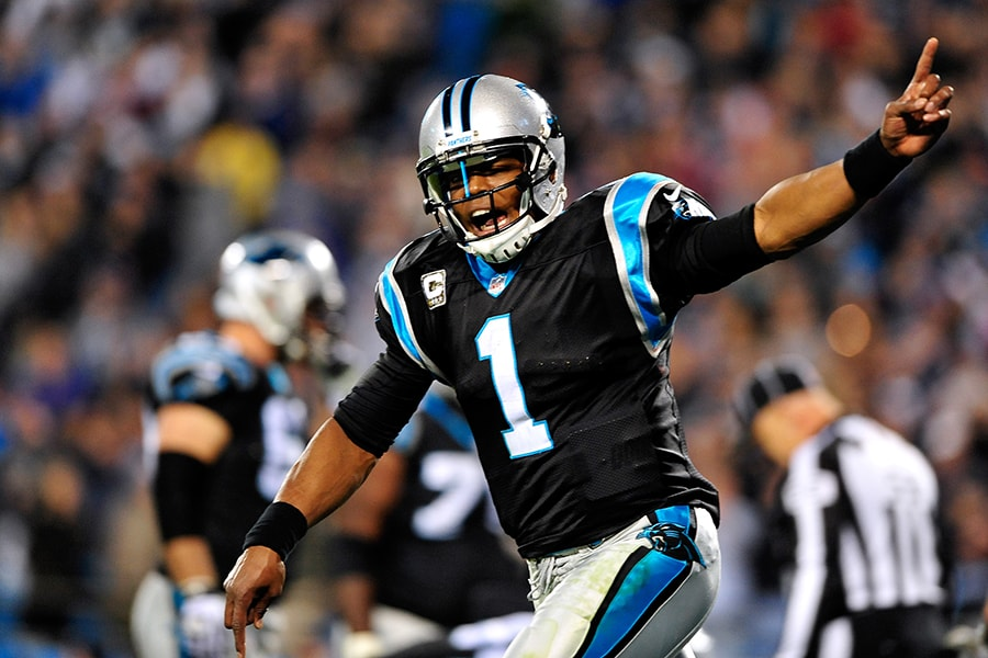 CHARLOTTE, NC - NOVEMBER 18: Cam Newton #1 of the Carolina Panthers celebrates after throwing the game-winning touchdown late in the fourth quarter against the New England Patriots during play at Bank of America Stadium on November 18, 2013 in Charlotte, North Carolina. The Panthers won 24-20. (Photo by Grant Halverson/Getty Images)