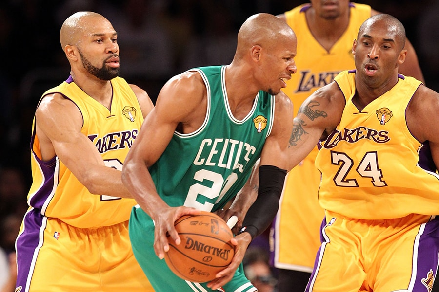 LOS ANGELES, CA - JUNE 17: Ray Allen #20 of the Boston Celtics looks to move the ball as he is covered by Derek Fisher #2 and Kobe Bryant #24 of the Los Angeles Lakers in the first quarter of Game Seven of the 2010 NBA Finals at Staples Center on June 17, 2010 in Los Angeles, California. NOTE TO USER: User expressly acknowledges and agrees that, by downloading and/or using this Photograph, user is consenting to the terms and conditions of the Getty Images License Agreement. (Photo by Ronald Martinez/Getty Images)