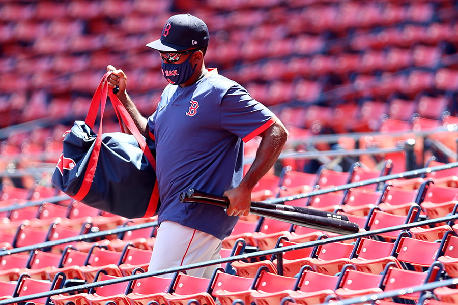 BOSTON, MASSACHUSETTS - JULY 12: Jackie Bradley Jr. #19 of the Boston Red Sox walks to the field wearing a mask during Summer Workouts at Fenway Park on July 12, 2020 in Boston, Massachusetts. (Photo by Maddie Meyer/Getty Images)