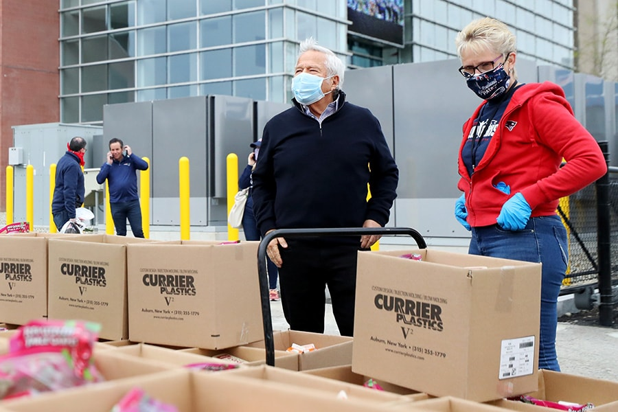 """FOXBOROUGH, MASSACHUSETTS - MAY 08: New England Patriots owner Robert Kraft and Patriots Community Relations Director Donna Spigarolo look over boxes of food at the """"Soup-R Bowl"""" at Gillette Stadium on May 08, 2020 in Foxborough, Massachusetts. The Patriots Foundation and Massachusetts Military Support Foundation worked in partnership to provide meals to 1000 military families suffering from food insecurity. (Photo by Maddie Meyer/Getty Images)"""