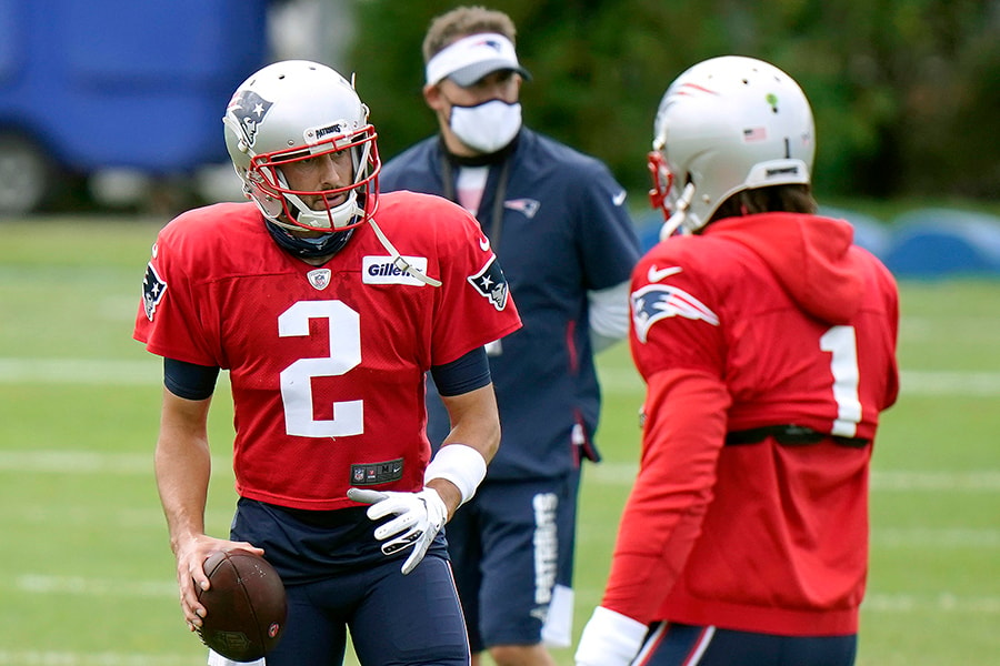 FOXBOROUGH, MASSACHUSETTS - AUGUST 17: Brian Hoyer #2 of the New England Patriots talks with Cam Newton #1 during training camp at Gillette Stadium on August 17, 2020 in Foxborough, Massachusetts. (Photo by Steven Senne-Pool/Getty Images)