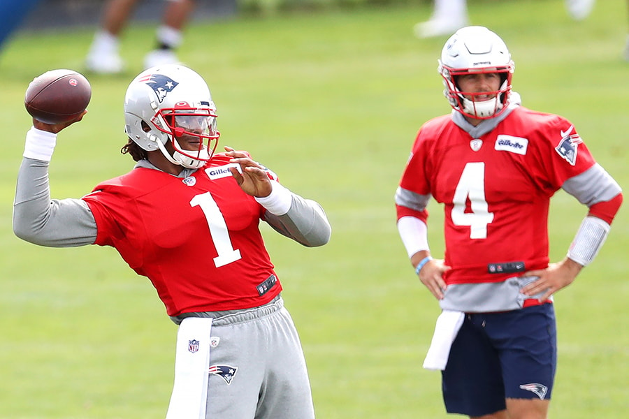 FOXBOROUGH, MASSACHUSETTS - AUGUST 26: Cam Newton #1 of the New England Patriots makes a throw as Jarrett Stidham #4 looks on during Patriots Training camp at Gillette Stadium on August 26, 2020 in Foxborough, Massachusetts. (Photo by Maddie Meyer/Getty Images)