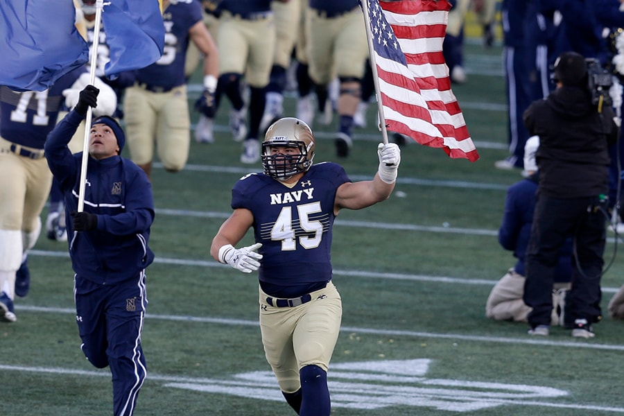 ANNAPOLIS, MD - NOVEMBER 15: Paul Quessenberry #45 of Navy Midshipmen leads the team onto the field before the start of their game against the Georgia Southern Eagles at the Navy-Marines Memorial Stadium on November 15, 2014 in Annapolis, Maryland. (Photo by Chris Gardner/Getty Images)