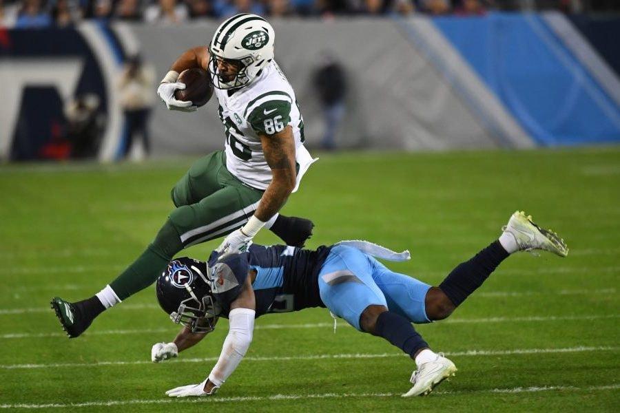 Dec 2, 2018; Nashville, TN, USA; New York Jets tight end Jordan Leggett (86) is tackled by Tennessee Titans cornerback LeShaun Sims (36) during the second half at Nissan Stadium. Mandatory Credit: Christopher Hanewinckel-USA TODAY Sports