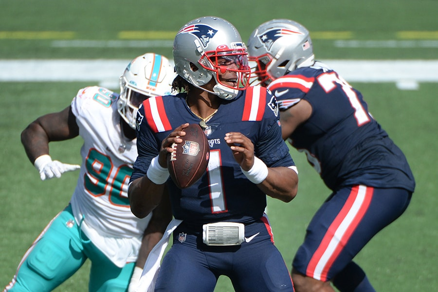 FOXBOROUGH, MASSACHUSETTS - SEPTEMBER 13: Cam Newton #1 of the New England Patriots looks to pass during the second half against the Miami Dolphins at Gillette Stadium on September 13, 2020 in Foxborough, Massachusetts. (Photo by Kathryn Riley/Getty Images)