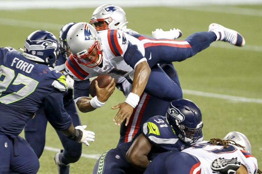 Sep 20, 2020; Seattle, Washington, USA; New England Patriots quarterback Cam Newton (1) is tackled shy of the goal line for the final play of a 35-30 loss against the Seattle Seahawks at CenturyLink Field. Mandatory Credit: Joe Nicholson-USA TODAY Sports