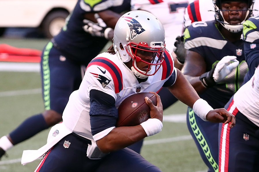 SEATTLE, WASHINGTON - SEPTEMBER 20: Cam Newton #1 of the New England Patriots runs with the ball during the first half against the Seattle Seahawks at CenturyLink Field on September 20, 2020 in Seattle, Washington. (Photo by Abbie Parr/Getty Images)