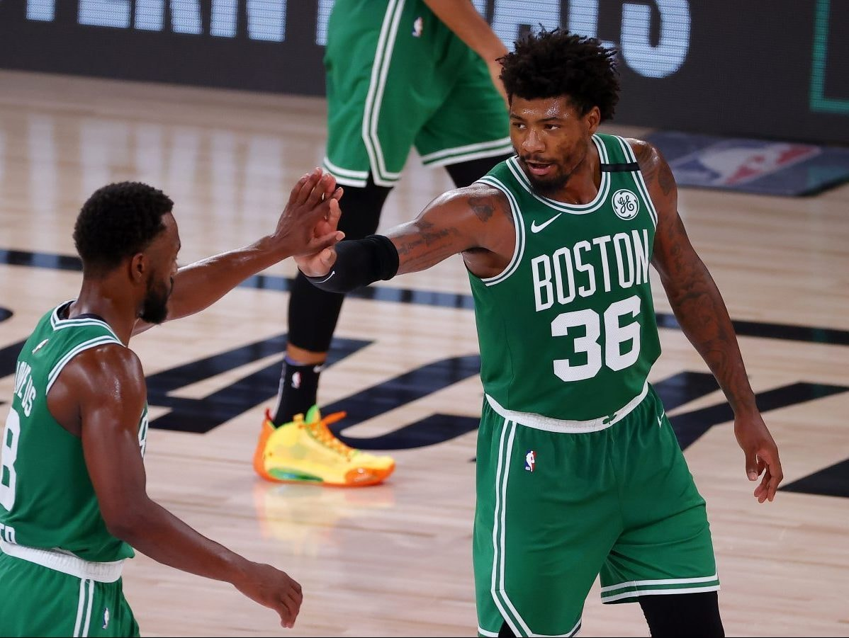 LAKE BUENA VISTA, FLORIDA - SEPTEMBER 19: Marcus Smart #36 of the Boston Celtics reacts with Kemba Walker #8 of the Boston Celtics during the fourth quarter against the Miami Heat in Game Three of the Eastern Conference Finals during the 2020 NBA Playoffs at AdventHealth Arena at the ESPN Wide World Of Sports Complex on September 19, 2020 in Lake Buena Vista, Florida. NOTE TO USER: User expressly acknowledges and agrees that, by downloading and or using this photograph, User is consenting to the terms and conditions of the Getty Images License Agreement. (Photo by Kevin C. Cox/Getty Images)