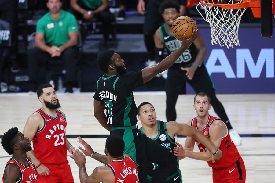 Sep 7, 2020; Lake Buena Vista, Florida, USA; Boston Celtics guard Jaylen Brown (7) makes a layup against the Toronto Raptors during the second half of game five of the second round in the 2020 NBA Playoffs at ESPN Wide World of Sports Complex. Mandatory Credit: Kim Klement-USA TODAY Sports