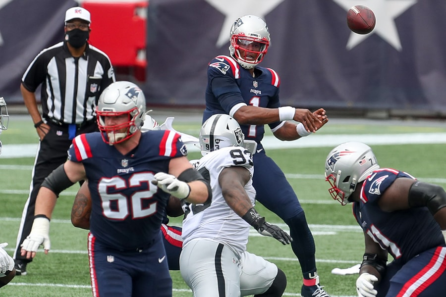 Sep 27, 2020; Foxborough, Massachusetts, USA; New England Patriots quarterback Cam Newton (1) passes the ball to New England Patriots running back Rex Burkhead (34) during the first half against the Las Vegas Raiders at Gillette Stadium. Mandatory Credit: Paul Rutherford-USA TODAY Sports