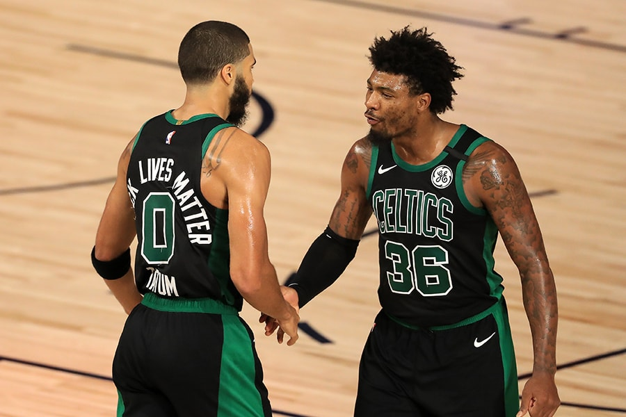 LAKE BUENA VISTA, FLORIDA - SEPTEMBER 01: Jayson Tatum #0 of the Boston Celtics and Marcus Smart #36 of the Boston Celtics react to a shot during the fourth quarter against the Toronto Raptors in Game Two of the Eastern Conference Second Round during the 2020 NBA Playoffs at The Field House at ESPN Wide World Of Sports Complex on September 01, 2020 in Lake Buena Vista, Florida. NOTE TO USER: User expressly acknowledges and agrees that, by downloading and or using this photograph, User is consenting to the terms and conditions of the Getty Images License Agreement. (Photo by Mike Ehrmann/Getty Images)