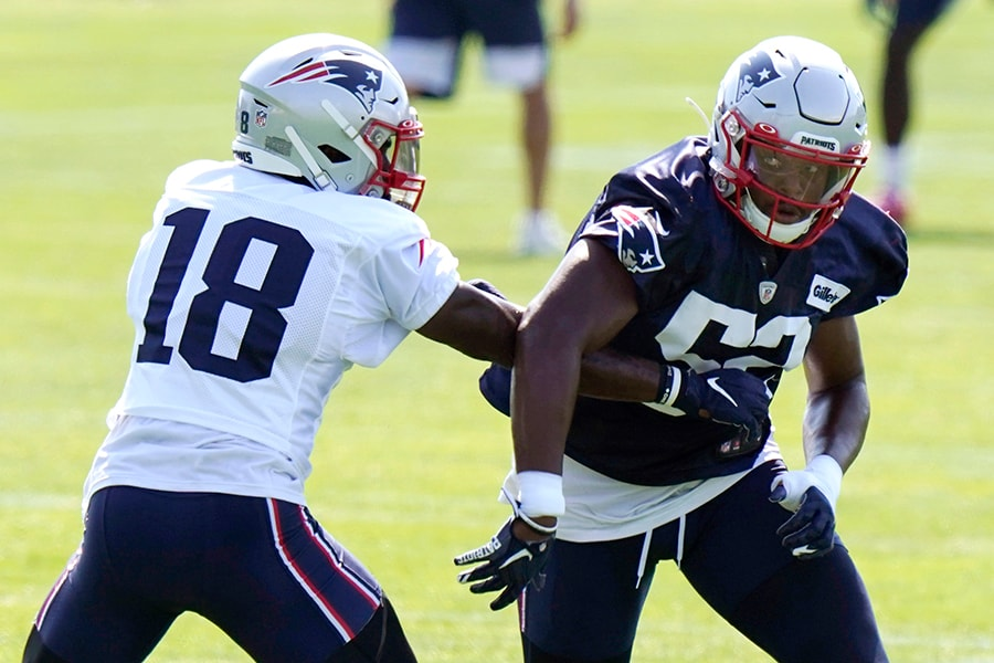 FOXBOROUGH, MASSACHUSETTS - AUGUST 23: Brandon Copeland #52 of the New England Patriots runs a drill against Matthew Slater #18 during training camp at Gillette Stadium on August 23, 2020 in Foxborough, Massachusetts. (Photo by Steven Senne-Pool/Getty Images)