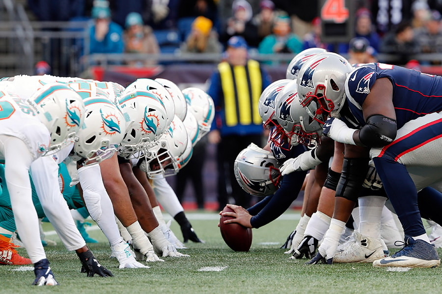 Dec 29, 2019; Foxborough, Massachusetts, USA; The New England Patriots and the Miami Dolphins line up for the snap at the line of scrimmage during the first half at Gillette Stadium. Mandatory Credit: Winslow Townson-USA TODAY Sports