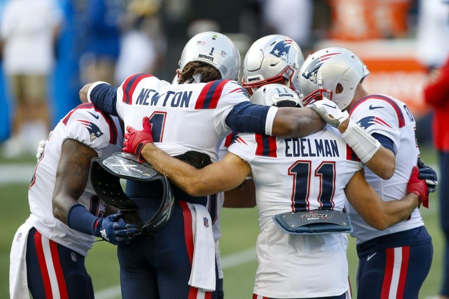 Cam Newton and Julian Edelman huddle with Patriots teammates during pregame warmups before the game against the Seattle Seahawks. (Joe Nicholson-USA TODAY Sports)