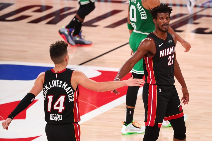 Sep 23, 2020; Lake Buena Vista, Florida, USA; Miami Heat guard Tyler Herro (14) reacts with forward Jimmy Butler (22) during the second half of game four of the Eastern Conference Finals of the 2020 NBA Playoffs against the Boston Celtics at AdventHealth Arena. Mandatory Credit: Kim Klement-USA TODAY Sports