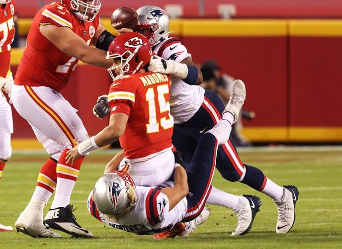 KANSAS CITY, MISSOURI - OCTOBER 05: Patrick Mahomes #15 of the Kansas City Chiefs is sacked by Chase Winovich #50 of the New England Patriots during the first half at Arrowhead Stadium on October 05, 2020 in Kansas City, Missouri. (Photo by Jamie Squire/Getty Images)