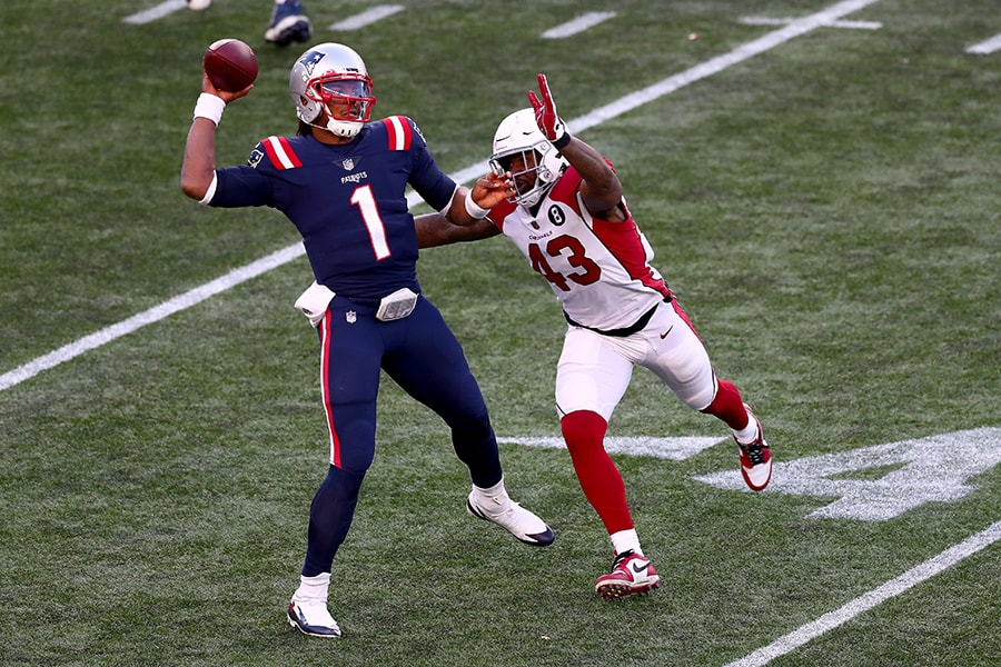FOXBOROUGH, MASSACHUSETTS - NOVEMBER 29: Cam Newton #1 of the New England Patriots looks to throw a pass against Haason Reddick #43 of the Arizona Cardinals during the third quarter of the game at Gillette Stadium on November 29, 2020 in Foxborough, Massachusetts. (Photo by Adam Glanzman/Getty Images)