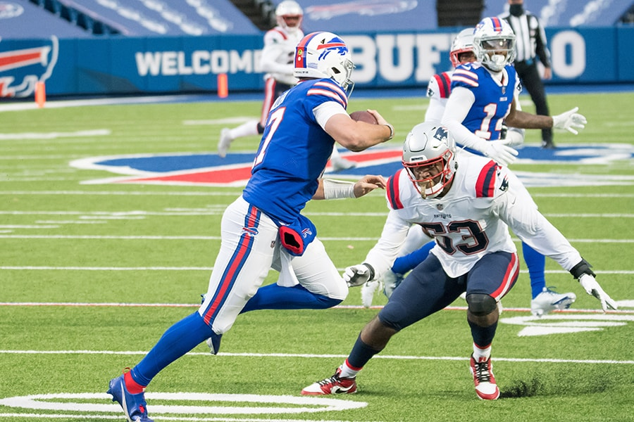 Nov 1, 2020; Orchard Park, New York, USA; New England Patriots linebacker Josh Uche prepares to tackle Buffalo Bills quarterback Josh Allen (17) in the third quarter at Bills Stadium. Mandatory Credit: Mark Konezny-USA TODAY Sports