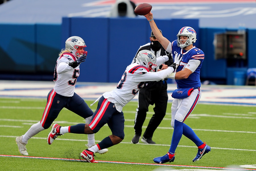 Josh Uche had one of his better games of the season in the Patriots' first meeting against Josh Allen and the Bills. (Photo by Timothy T Ludwig/Getty Images)