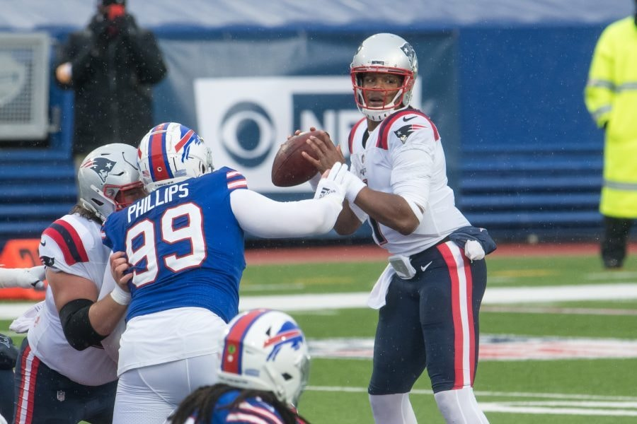 Nov 1, 2020; Orchard Park, New York, USA; New England Patriots quarterback Cam Newton (1) stands in the pocket to throw a pass as Buffalo Bills defensive tackle Harrison Phillips (99) rushes in the first quarter at Bills Stadium. Mandatory Credit: Mark Konezny-USA TODAY Sports