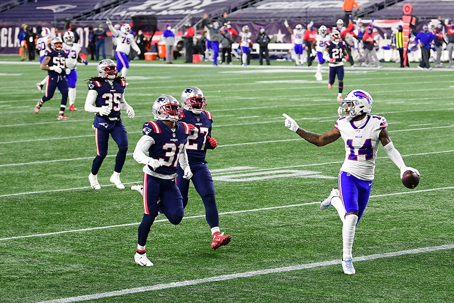 FOXBOROUGH, MASSACHUSETTS - DECEMBER 28: Stefon Diggs #14 of the Buffalo Bills reacts as he runs into the end zone for a touchdown as Jonathan Jones #31 and J.C. Jackson #27 of the New England Patriots give chase during the first half at Gillette Stadium on December 28, 2020 in Foxborough, Massachusetts. (Photo by Billie Weiss/Getty Images)