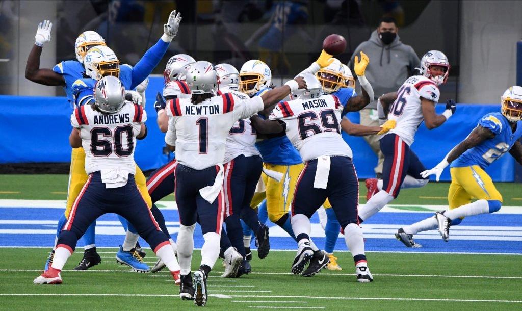 Patriots quarterback Cam Newton throws a pass over the Los Angeles Chargers defensive line during the third quarter at SoFi Stadium. (Robert Hanashiro-USA TODAY Sports)