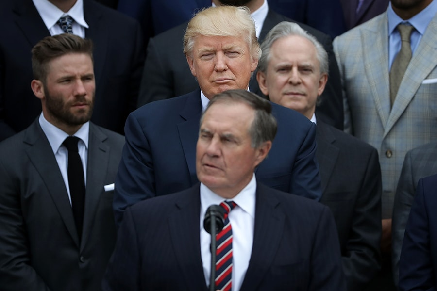 WASHINGTON, DC - APRIL 19: U.S. President Donald Trump (C) listens to New England Patriots Head Coach Bill Belichick deliver remarks during an event celebrating the team's Super Bowl win on the South Lawn at the White House April 19, 2017 in Washington, DC. It was the team's fifth Super Bowl victory since 1960. (Photo by Chip Somodevilla/Getty Images)