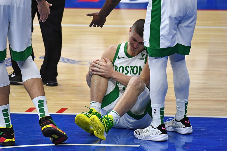 Jan 22, 2021; Philadelphia, Pennsylvania, USA; Boston Celtics guard Payton Pritchard (11) holds his knee after being injured against the Philadelphia 76ers at Wells Fargo Center. Mandatory Credit: Eric Hartline-USA TODAY Sports