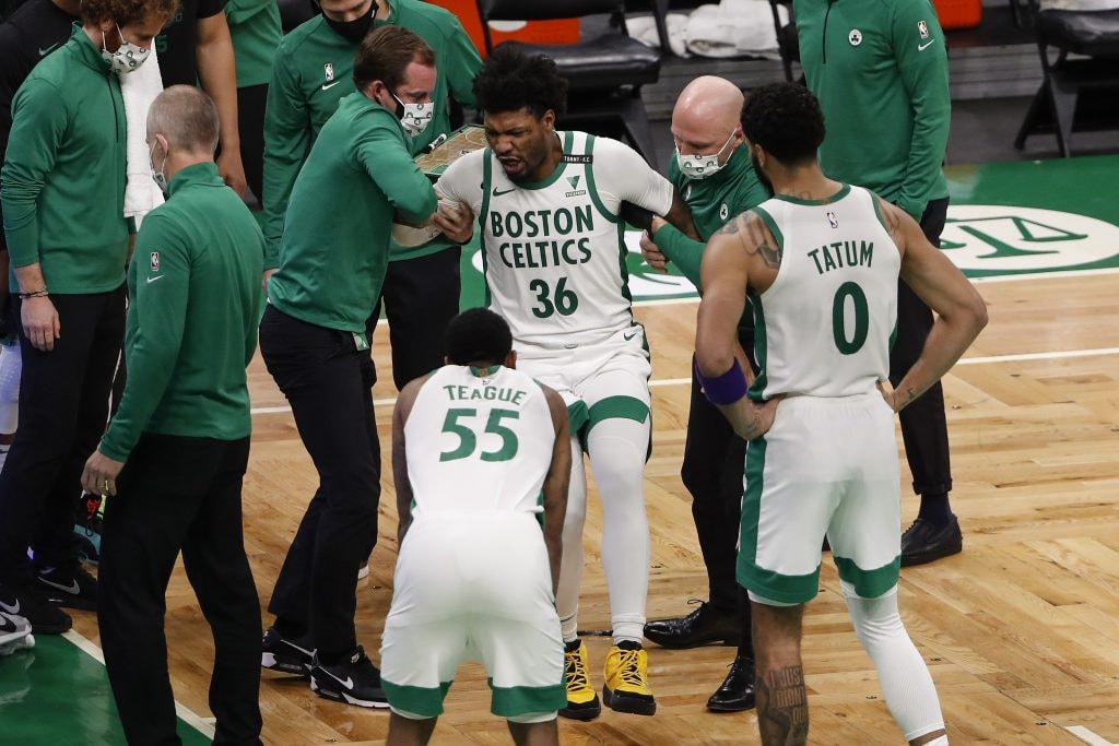 Celtics guard Marcus Smart (36) is helped up after being injured against the Los Angeles Lakers at TD Garden. (Winslow Townson-USA TODAY)